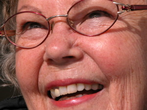 senior woman smiling wearing glasses